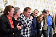 """(L-R) Actors Michael Madsen and Kurt Russell, director Quentin Tarantino, and actors Demian Bichir, Jennifer Jason Leigh, Walton Goggins, Tim Roth, and Bruce Dern attend """"The Hateful Eight"""" press room during Comic-Con International 2015 at the Hilton Bayfront on July 11, 2015 in San Diego, California."""