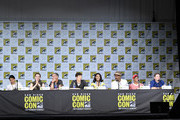 """(L-R) Actors Carlos Valdes, Danielle Panabaker, Tom Cavanagh, Grant Gustin, Candice Patton, Jesse L. Martin, Keiynan Lonsdale and Todd Helbing attend the """"The Flash"""" Video Presentation And Q+A  during Comic-Con International 2017 at San Diego Convention Center on July 22, 2017 in San Diego, California."""