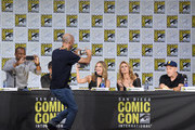 """Producer Chris Henze (2nd L) takes a photo of (L-R) actors Dule Hill, James Roday, Maggie Lawson, Kirsten Nelson, and Corbin Bernsen onstage at the """"Psych"""" reunion and movie sneak peek during Comic-Con International 2017 at San Diego Convention Center on July 21, 2017 in San Diego, California."""