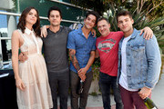 """(L-R) Actors Shelley Hennig, Dylan O'Brien, Tyler Posey, executive producer Jeff Davis and actor Cody Christian from """"Teen Wolf"""" celebrate their final season backstage after their Hall H panel during Comic-Con International 2017 at San Diego Convention Center on July 20, 2017 in San Diego, California."""