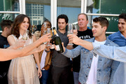 """(L-R) Actors Shelley Hennig, Khylin Rhambo, Dylan O'Brien, Cody Christian and Tyler Posey from """"Teen Wolf"""" celebrate their final season backstage after their Hall H panel during Comic-Con International 2017 at San Diego Convention Center on July 20, 2017 in San Diego, California."""