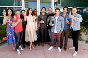 """(L-R) Actor Melissa Ponzio, executive producer Jeff Davis, actors Dylan Sprayberry, Shelley Hennig, Khylin Rhambo, Dylan O'Brien, Linden Ashby, Cody Christian, Tyler Posey, and Charlie Carver from """"Teen Wolf"""" celebrate their final season backstage after their Hall H panel during Comic-Con International 2017 at San Diego Convention Center on July 20, 2017 in San Diego, California."""