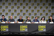 """(L-R) Steve Callaghan, Mike Henry, Rich Appel, Seth Green, Alec Sulkin, Alex Borstein, and Seth MacFarlane speak at the """"American Dad"""" and """"Family Guy"""" Panel during Comic-Con International 2018 at San Diego Convention Center on July 21, 2018 in San Diego, California."""