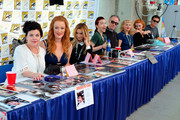 "(L-R) Sherilyn Fenn, Adele Rene, Amy Shiels, Chrysta Bell, Harry Goaz, Kimmy Robertson, Nicole LaLiberte and George Griffith attend ""Twin Peaks"" autograph signings and fan events during  Comic-Con International 2018 at San Diego Convention Center on July 21, 2018 in San Diego, California."
