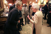 Queen Elizabeth II talks to Monica Galetti at a reception to celebrate the Commonwealth Diaspora community, in the lead up to the Commonwealth Heads of Government meeting in London this April, at Buckingham Palace on February 14, 2018 in London, England.