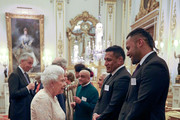 Queen Elizabeth II meets rugby players Mako (2nd right) and Billy Vunipola at a reception to celebrate the Commonwealth Diaspora community, in the lead up to the Commonwealth Heads of Government meeting in London this April, at Buckingham Palace on February 14, 2018 in London, England.