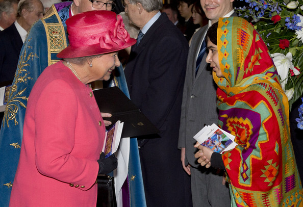 Queen Elizabeth II meets Malala Yousafzai as they attend the Commonwealth day observance service at Westminster Abbey on March 10, 2014 in London, England.
