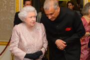 Queen Elizabeth II and Commonwealth Secretary General Kamalesh Sharma at the Commonwealth Reception at Marlborough House on March 10, 2014 in London, England.