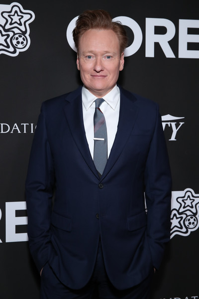 Sean Penn, Bryan Lourd And Vivi Nevo Host 10th Anniversary Gala Benefiting CORE - Arrivals [suit,formal wear,tuxedo,white-collar worker,premiere,tie,outerwear,carpet,event,bow tie,arrivals,bryan lourd,sean penn,conan obrien,vivi nevo,10th anniversary gala benefiting core,vivi nevo host 10th anniversary gala benefiting core,wiltern theatre,los angeles,california,conan obrien,getty images,stock photography,photograph,celebrity,image,primetime emmy award for outstanding writing - variety series,television presenter,television]