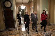 Senate Majority Leader Mitch McConnell (C) (R-KY) walks to the floor of the U.S. Senate just before midnight February 8, 2018 in Washington, DC. After a delay caused by Sen. Rand Paul (R-KY), both the Senate and the House of Representatives are expected to vote in the early morning on a long term funding bill following an agreement between Republican and Democratic leaders in the U.S. Senate.