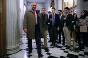 Sen. Tim Kaine (D-VA) (L) and Sen. Roy Blunt (R-MO) (2nd L) pass by repoters on their way to the Senate Chamber for early morning votes at the U.S. Capitol February 9, 2018 in Washington, DC. Despite an attempt by Sen. Rand Paul (R-KY) to slow down the process, the Senate passed bipartisan legislation to continue to fund the government and lift strict budget caps. With the government officially in a shut down, the legislation now goes to the House of Representatives.