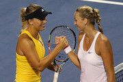 Caroline Wozniaki of Denmark congratulates Petra Kvitova of Czech Republic after their semifinal round match of the Connecticut Open at Connecticut Tennis Center at Yale on August 28, 2015 in New Haven, Connecticut.