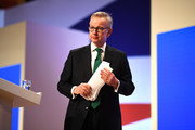 Secretary of State for Environment, Food and Rural Affairs Michael Gove leaves the stage after speaking on day two of the annual Conservative Party Conference on October 1, 2018 in Birmingham, England. This year it is being held against a backdrop of party division on Brexit.  The Prime Minister is pushing ahead with her unpopular Chequers Deal which promises a softer Brexit creating a free trade area with the EU enabling frictionless access for goods and avoids the need for a hard border between Northern Ireland in Ireland. This plan has divided the Conservative party.