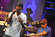 Hip-hop artists Pharrell Williams and Chad Hugo of N.E.R.D. perform during the Coors Light Search for the Coldest National competition and tour at Highline Ballroom on May 31, 2011 in New York, New York.