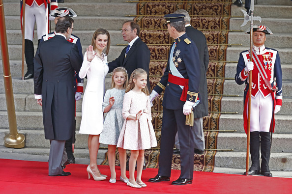 Prime Minister Mariano Rajoy (L) arrives with King Felipe VI of Spain and Queen Letizia of Spain, Princess Leonor,  Princess of Asturias and Princess Sofia at the Lions Gate at the Congress of Deputies during the King's official coronation ceremony on June 19, 2014 in Madrid, Spain. The coronation of King Felipe VI is held in Madrid. His father, the former King Juan Carlos of Spain abdicated on June 2nd after a 39 year reign. The new King is joined by his wife Queen Letizia of Spain.