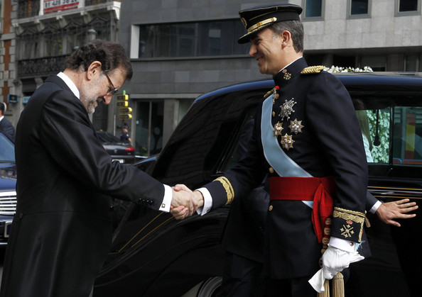King Felipe VI of Spain is greeted by Prime Minister Mariano Rajoy at the Congress of Deputies to make his proclamation as King of Spain to the Spanish Parliament. on June 19, 2014 in Madrid, Spain. The coronation of King Felipe VI is held in Madrid. His father, the former King Juan Carlos of Spain abdicated on June 2nd after a 39 year reign. The new King is joined by his wife Queen Letizia of Spain.