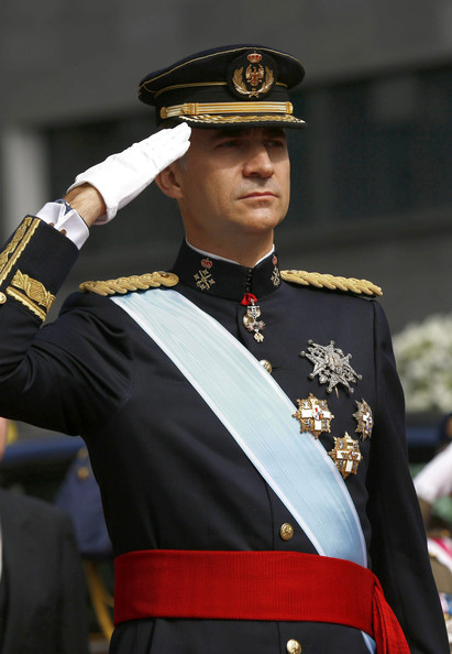 King Felipe VI of Spain salutes a parade of Civil Guard at the Congress of Deputies prior to the King's official coronation ceremony on June 19, 2014 in Madrid, Spain. The coronation of King Felipe VI is held in Madrid. His father, the former King Juan Carlos of Spain abdicated on June 2nd after a 39 year reign. The new King is joined by his wife Queen Letizia of Spain.
