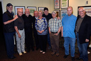 """David Briggs, Bergen White, Jimmy Capps, Bill Walker, Jeanine Walker, Eddie Bayers, Charlie McCoy (HoF), Hargus """"Pig"""" Robbins (HoF), and Steve Gibson backstage during Nashville Cats: A Salute to Bill Walker at The Country Music Hall of Fame and Museum on May 30, 2015 in Nashville, Tennessee."""