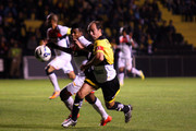 Paulo Baier (R) of Criciuma struggles for the ball with a Marcelo of Vitoria during a match between Criciuma and Vitoria for the Brazilian Series A 2014 at Heriberto Hulse Stadium on July 26, 2014 in Criciuma, Brazil.
