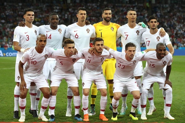 Uruguay v Portugal: Round of 16 - 2018 FIFA World Cup Russia [player,team,sports,soccer player,team sport,ball game,football player,sport venue,tournament,championship,team photo,portugal,russia,uruguay,fisht stadium,sochi,round,2018 fifa world cup,match]