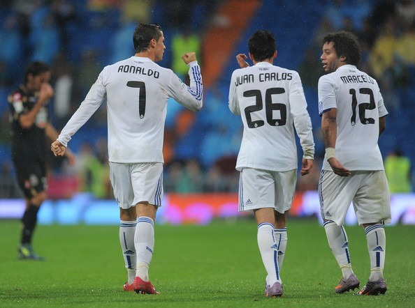 Cristiano Ronaldo Cristiano Ronaldo of Real Madrid celebrates with Juan Carlos and Marcelo  after scoring Real's sixth goal during the La Liga match against Deportivo La Coruna  at Estadio Santiago Bernabeu on October 3, 2010 in Madrid, Spain.