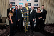 RuPaul (C) and fellow producers, winners of the Best Competition Series award for 'RuPaul's Drag Race' poses in the press room during the Critics' Choice Real TV Awards at The Beverly Hilton Hotel on June 02, 2019 in Beverly Hills, California.