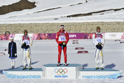 (FRANCE OUT) Dario Cologna of Switzerland wins gold medal, Johan Olsson of Sweden wins silver medal, Daniel Richardsson of Sweden wins bronze medal during the Cross-Country Men's 15km Classic at the Laura Cross-country Ski & Biathlon Center on February 14, 2014 in Sochi, Russia.