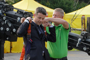 Prince Frederik of Denmark wears a safety harness before he goes up to make the world's tallest Lego World Tower during an event at the Seoul Olympic Stadium on May 13, 2012 in Seoul, South Korea. The Crown Prince and Crown Princess of Denmark are on a six-day visit to South Korea.