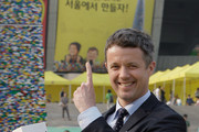 Prince Frederik of Denmark holds the last Lego bricks to go the world's tallest Lego tower at the Seoul Olympic Stadium on May 13, 2012 in Seoul, South Korea. The Crown Prince and Crown Princess of Denmark are on a six-day visit to South Korea.