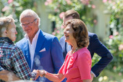King Carl Gustrav and Queen Sylvia of Sweden greet members of the audience at The Crown Princess Victoria of Sweden's 42nd birthday celebrations on July 14, 2019 at Solliden Palace in Borgholm, Oland, Sweden.