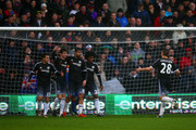 Oscar of Chelsea celebrates with team-mates Pedro, Diego Costa and Willian of Chelsea after scoring the opening goal during the Barclays Premier League match between Crystal Palace and Chelsea at Selhurst Park on January 3, 2016 in London, England.