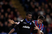 Kanu of Portsmouth is tackled during the npower Championship match between Crystal Palace and Portsmouth at Selhurst Park on September 14, 2010 in London, England.
