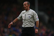 Referee Mike Dean gestures during the Barclays Premier League match between Crystal Palace and Southampton at Selhurst Park on December 12, 2015 in London, United Kingdom.