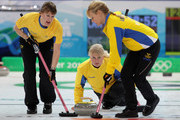 Anette Norberg (C) of Sweden releases a stone as Cathrine Lindahl (L) and Anna Le Moine sweep the ice during the women's gold medal curling game between Canada and Sweden on day 15 of the Vancouver 2010 Winter Olympics at Vancouver Olympic Centre on February 26, 2010 in Vancouver, Canada.