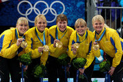 (L-R) Kajsa Bergstroem, Anna Le Moine, Cathrine Lindahl, Eva Lund and Anette Norberg of Sweden pose with their gold medals after victory over Canada in the women's gold medal curling game between Canada and Sweden on day 15 of the Vancouver 2010 Winter Olympics at Vancouver Olympic Centre on February 26, 2010 in Vancouver, Canada.