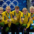 Cathrine Lindahl Eva Lund Photos - (L-R) Kajsa Bergstroem, Anna Le Moine, Cathrine Lindahl, Eva Lund and Anette Norberg of Sweden pose with their gold medals after victory over Canada in the women's gold medal curling game between Canada and Sweden on day 15 of the Vancouver 2010 Winter Olympics at Vancouver Olympic Centre on February 26, 2010 in Vancouver, Canada. - Olympic Curling - Day 15