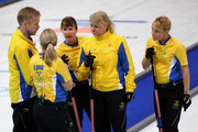 Anette Norberg (2R), Eva Lund (2L), Cathrine Lindahl (C) and Anna Le Moine (R) talk with their coach, Stefan Lund, during the women's gold medal curling game between Canada and Sweden on day 15 of the Vancouver 2010 Winter Olympics at Vancouver Olympic Centre on February 26, 2010 in Vancouver, Canada.