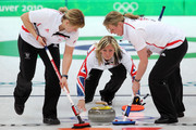 Skip Eve Muirhead of Great Britain delivers while Kelly Wood and Lorna Vevers sweep during the women's curling round robin game against Russia on day 7 of the Vancouver 2010 Winter Olympics at Vancouver Olympic Centre on February 18, 2010 in Vancouver, Canada.