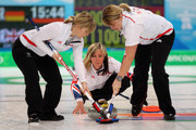 Eve Muirhead (C) of Great Britain and Northern Ireland releases the stone as Kelly Wood (L) and Lorna Vevers brush the ice during the Women's Curling Round Robin match between Germany and Great Britain on day 8 of the Vancouver 2010 Winter Olympics at the Vancouver Olympic Centre on February 19, 2010 in Vancouver, Canada.