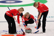 Eve Muirhead of Great Britain releases the stone as Kelly Wood (L)  and Lorna Vevers brush the ice during the Women's Curling Round Robin match between Great Britain and Japan on day 8 of the Vancouver 2010 Winter Olympics at the Vancouver Olympic Centre on February 19, 2010 in Vancouver, Canada.