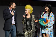 (L-R) Loren Saveier, Cyndi Lauper and Kesha speak onstage at the Cyndi Lauper And Friends: Home For The Holidays Benefit at The Novo by Microsoft on December 10, 2019 in Los Angeles, California.