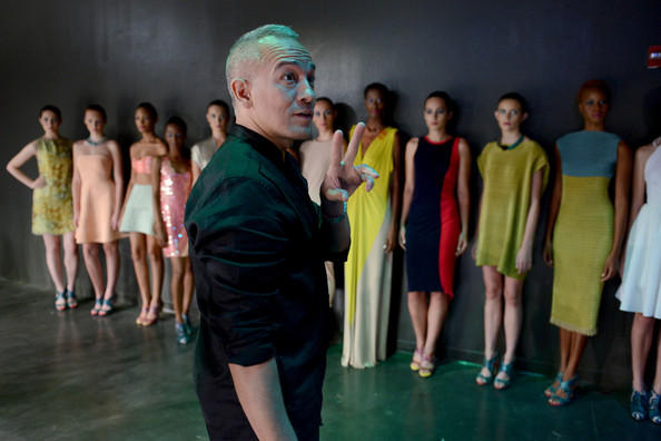 Fashion designer Cesar Galindo (C) and models prepare backstage at the Czar By Cesar Galindo presentation during Mercedes-Benz Fashion Week Spring 2015 at The Hub at The Hudson Hotel on September 7, 2014 in New York City.