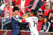 Alvaro Fernandez #4 of Chicago Fire and Andy Najar #14 of DC United fight for the ball at Toyota Park on Octotber 27, 2012 in Bridgeview, Illinois.