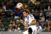 Alan Gordon #9 of the Los Angeles Galaxy passes the ball on a header over Sean Franklin #5 of D.C. United during the second half at StubHub Center on August 27, 2014 in Los Angeles, California.