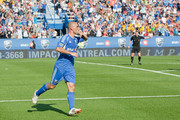 Marco Di Vaio #9 of the Montreal Impact celebrates his first half goal by kissing his ring during the MLS match against the D.C. United at Saputo Stadium on August 25, 2012 in Montreal, Quebec, Canada.