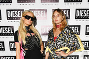 Paris Hilton (L) and Brandi Cyrus attend as DIESEL celebrates the exclusive launch of DIESEL Wynwood 28, their first residential building, with a DJ set by Amrit at Barter on December 04, 2019 in Miami, Florida.