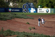 Justin Rose of England walks with his caddie Mark Fulcher on the ninth hole during the Pro Am prior to the start of the DP World Tour Championship, Dubai on the Earth Course at Jumeirah Golf Estates on November 12, 2013 in Dubai, United Arab Emirates.