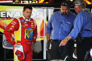 Tony Stewart, driver of the #33 Oreo/Ritz Chevrolet, and NASCAR Nationwide Series Director Joe Balash looks at the debris of the #32 Clorox Chevrolet, driven by Kyle Larson, following an incident at the finish of the NASCAR Nationwide Series DRIVE4COPD 300 at Daytona International Speedway on February 23, 2013 in Daytona Beach, Florida.