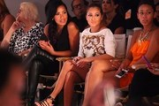 (L-R) Julissa Bermudez and Adrienne Bailon attend the Daisy Fuentes spring 2013 fashion show during Style360 at the Metropolitan Pavillion on September 12, 2012 in New York City.
