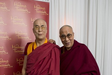 Dalai Lama (FILE) Celebs Pose with Their Wax Figures